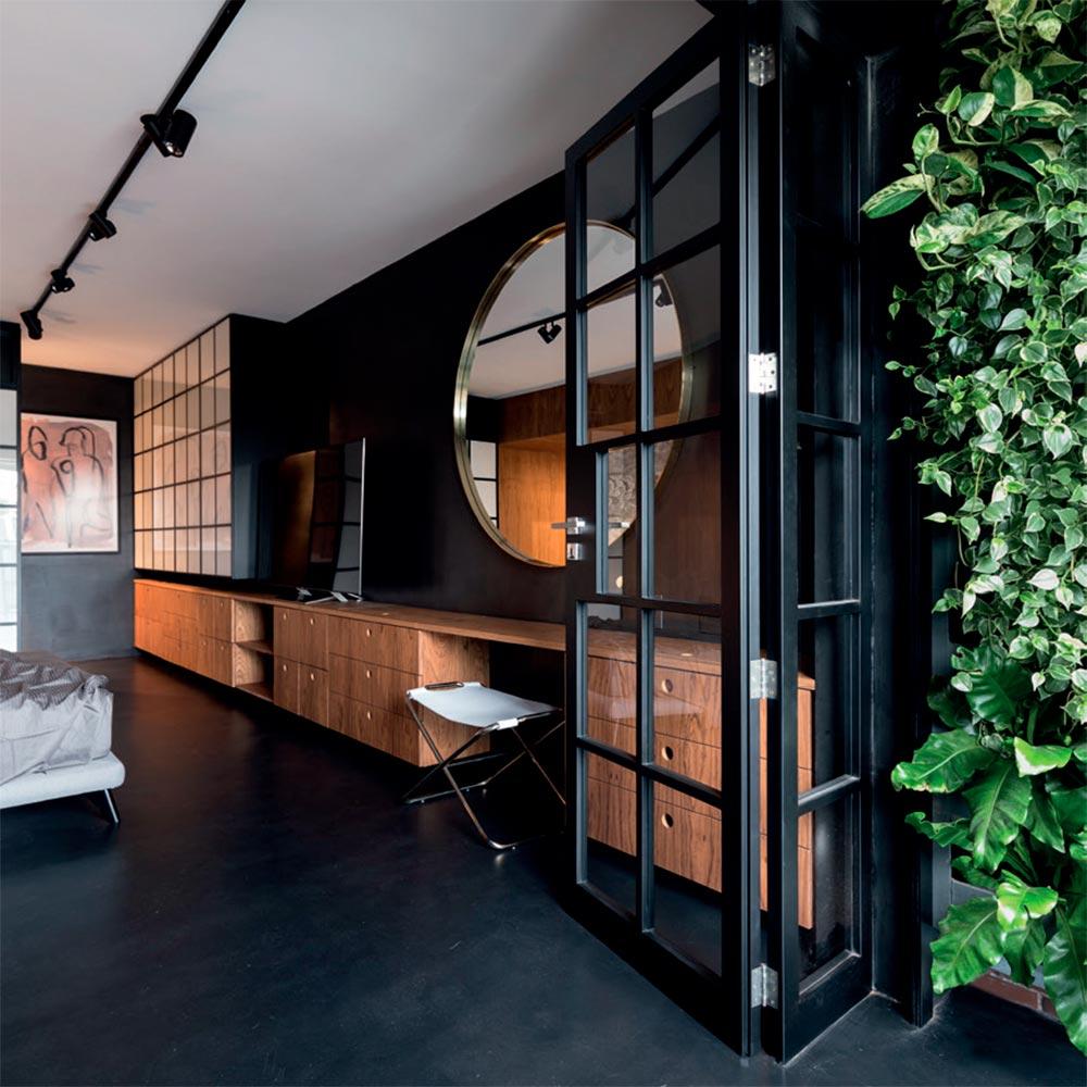 Apartamento projetado para apaixonados por arte, design e literatura