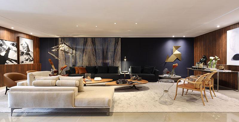 Painel de pedra brasileira é o destaque deste loft de 120 m²