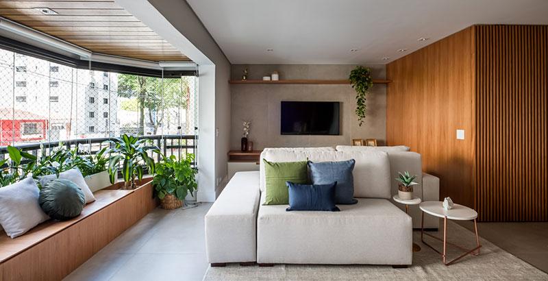 Apartamento de 140 m² ganha integração e décor em tons neutros