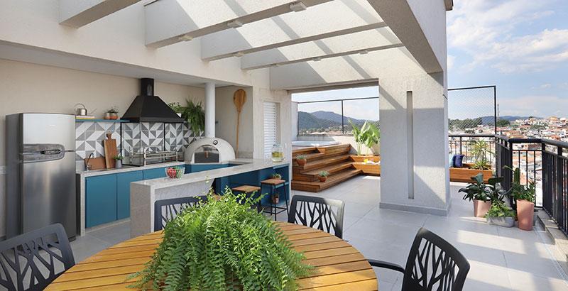 Apartamento dúplex ganha terraço de lazer e décor em tons de laranja