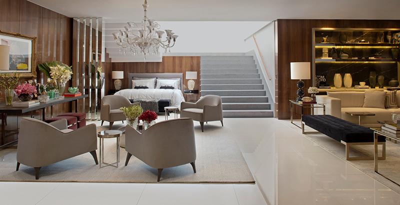 Loft cosmopolita ganha aconchego com o uso de muita madeira