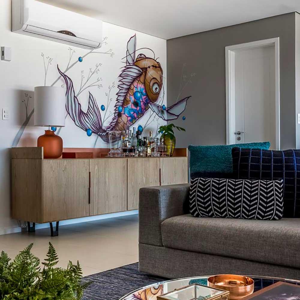 Apartamento de 130 m² ganha personalidade com grafite na parede da sala