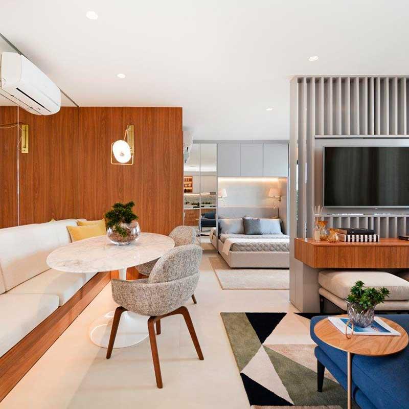 Mobiliário funcional aproveita o espaço deste loft de 48 m²